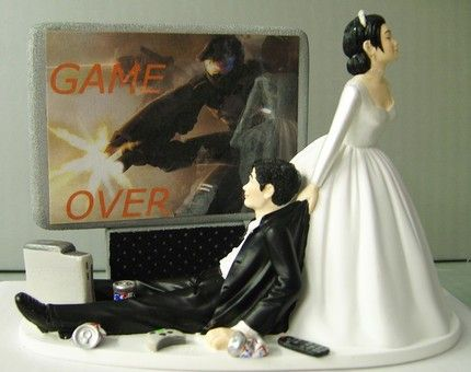 So Mike and I both agreed that we couldn't find a more perfect wedding cake topper!! If I can find this I think I'll pop the Game Over part off but love the fact that she is dragging him from the video games haha