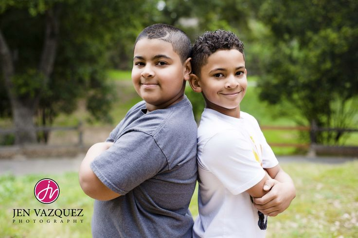 Real Kids by Jen Vazquez Photography. We love photographing ages of 5-15. Don't miss this important time as they change every day! Photographed at Edenvale Park in San Jose, California next to Hayes Mansion - see our images on our website at jenvazquez.com | Real Kids by Jen Vazquez Photography - two brothers photographed in a park with green trees