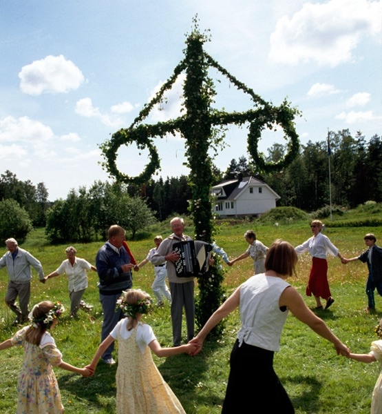 Midsommardagen is Sweden's traditional midsummer festival, observed throughout the country and in full bloom during the month of June. On Midsummer's Eve, which is always on a Friday, young girls place nine different flowers under their pillows to dream of their future husbands, while on Midsummer's Day, flower wreaths are worn while men, women and children dance around the maypole.
