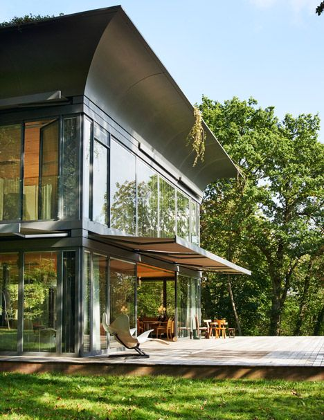 The Montfort residence is the model for the French designer's second series of prefab eco-houses produced in partnership with Riko, one of the leading European manufacturers of prefabricated wooden buildings. PATH homes by Philippe Starck and Riko