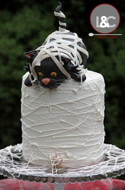 Mummy black cat birthday cake  www.tablescapesbydesign.com https://www.facebook.com/pages/Tablescapes-By-Design/129811416695