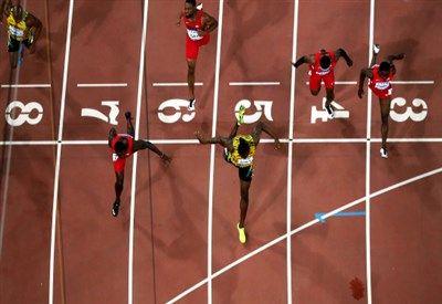 Usain Bolt e Justin Gatlin, 100 m(Infophoto)
