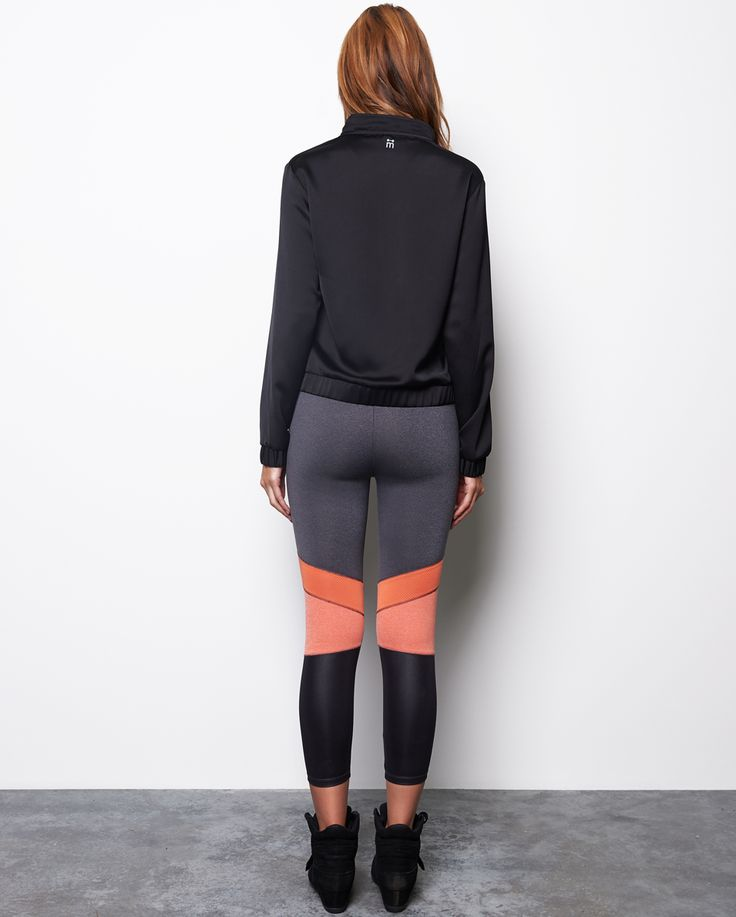 This classic 90's style bomber jacket is the statement piece of the season. With its metallic, light weight fabric and utility features, this item is the perfect layering piece to take you from day to night. Pair it up with our Jayne F/L Tight and Sissy Neoprene Crop, you're ready for a night out on the town.