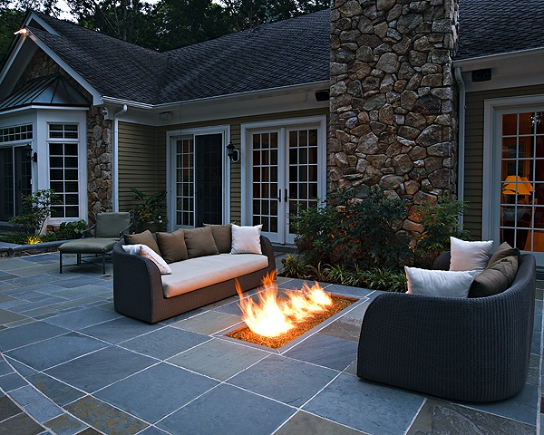 Fire pit flush with ground by Beechwood Landscape and Architecture. Keep your feet warm!
