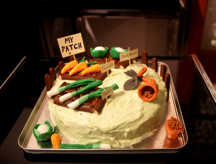 I'm thinking of entering a cake in our Allotment's show. Decorated with an #allotment theme. Inspiration. Allotment carrot cake.