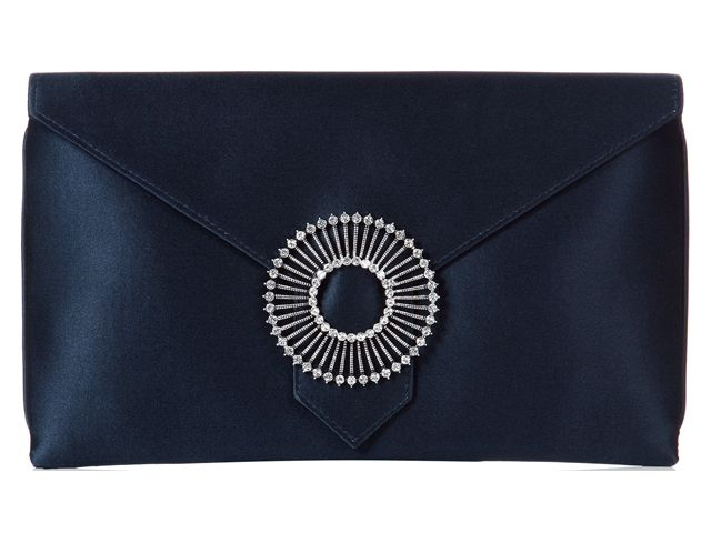 A fabulous Edith Navy Ink Blue envelope clutch bag from Wilbur & Gussie. This bag has been beautifully designed with a 100% navy blue silk fabric and has a jewel encrusted brooch. Bag has an optional wrist strap, inner pocket and magnetic fastening. View more bags from our Wilbur & Gussie Collection at: http://www.baroqueboutique.co.uk/wedding-shoes-and-accessories/