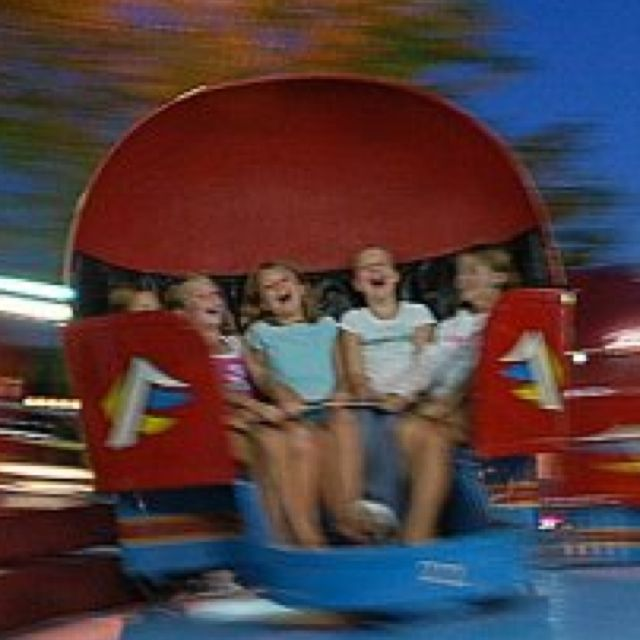 Tilt a whirl..I always want to barf after riding this! Fun with friends. Summertime at the fair. Remembering the 70's.