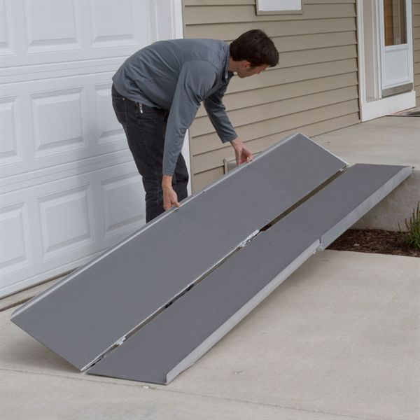Unfolding the scooter ramp in half