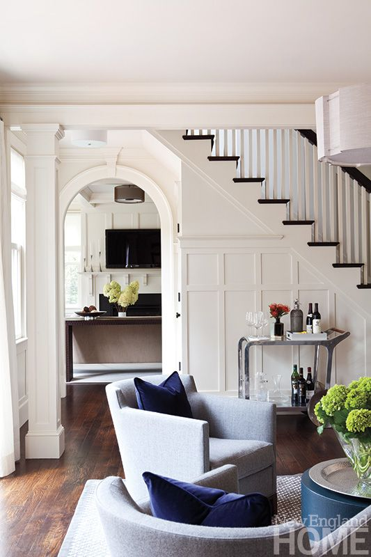 Gracious archways by architect Sally Weston recall New England elegance of the past, while LDa Architecture  Interiors' clean-lined furnishings open the rooms to modernity.