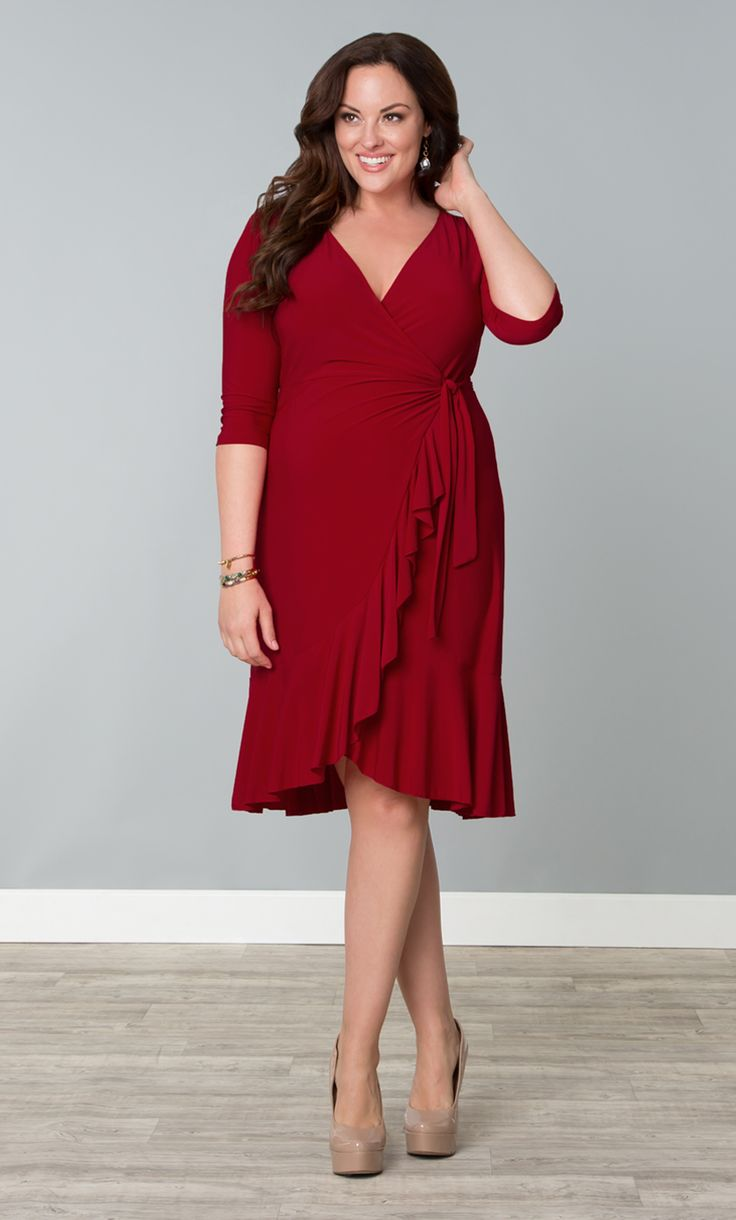 Check out our Whimsy Wrap Dress in a saucy red color for a hot night out.  This fully functional wrap dress is designed with beautiful cascading flounces along the hem for a flirty look.