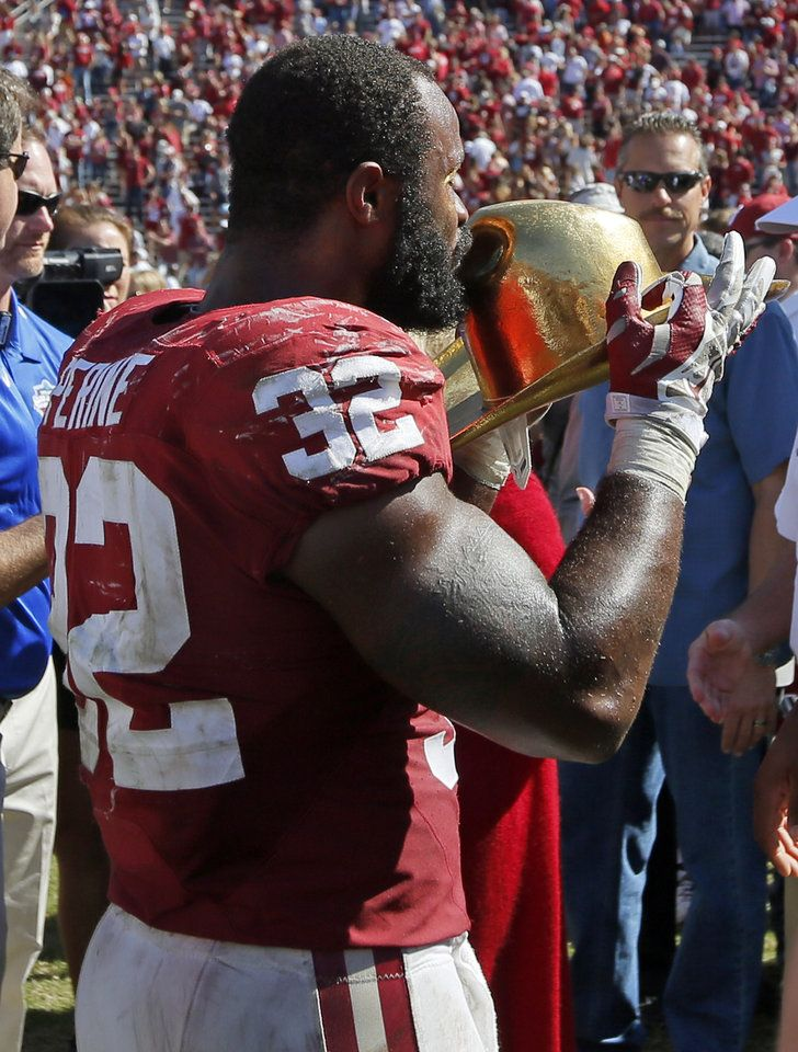 Oklahoma's Samaje Perine (32) kisses the Golden Hat trophy after the Red River Showdown college football game between the University of Oklahoma Sooners (OU) and the Texas Longhorns (UT) at Cotton Bowl Stadium in Dallas, Saturday, Oct. 8, 2016. OU won 45-40. Photo by Nate Billings, The Oklahoman