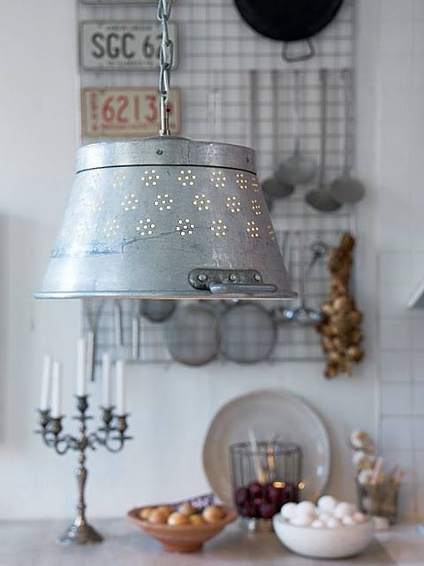 Vintage colander turned kitchen light fixture.....love it.