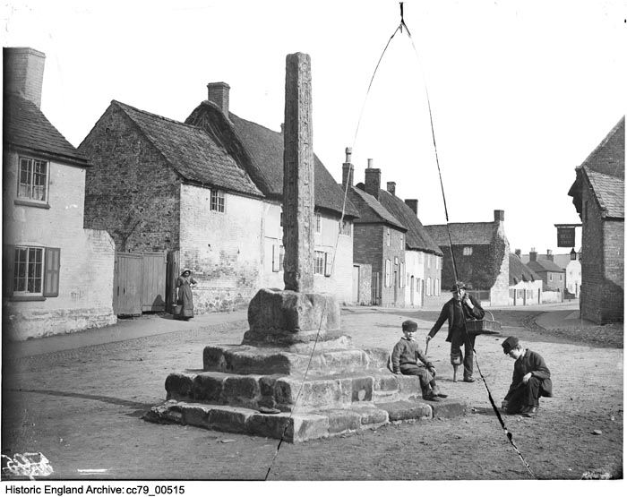 CC79/00515 Two children and a man wearing a wooden leg beside the village cross on Main Street,  Frisby On The Wreake, Leicestershire.  14 Mar 1885 Photographer: London Midland and Scottish Railway.  Please click on the image for more information or to search our catalogue for other images.