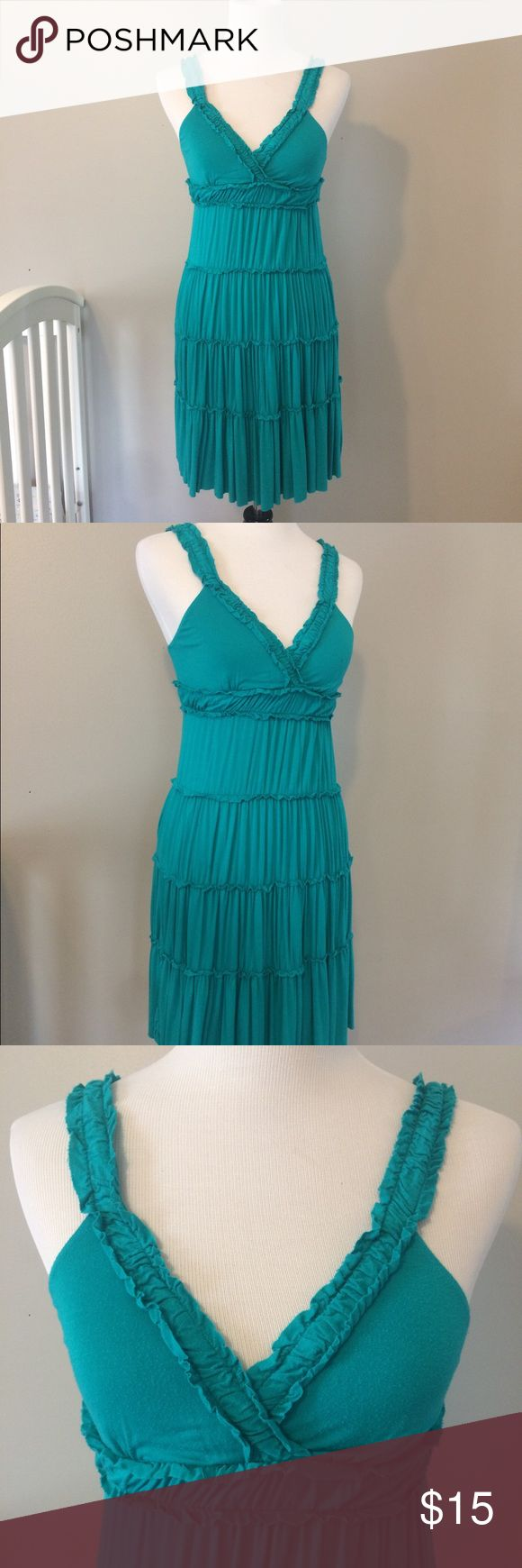 "MCM Turquoise Tiered Sun Dress with Ruffles From Dillard's, this dress is a bold teal/Turquoise color. It is light & flowy - comfortable & perfect for hot summer days! It's also a great swimsuit coverup. The material is rayon & spandex - it does have some pilling on parts of the dress (see photo). I'm 5'6"" & it hits just above the knee. MCM Dresses Midi"