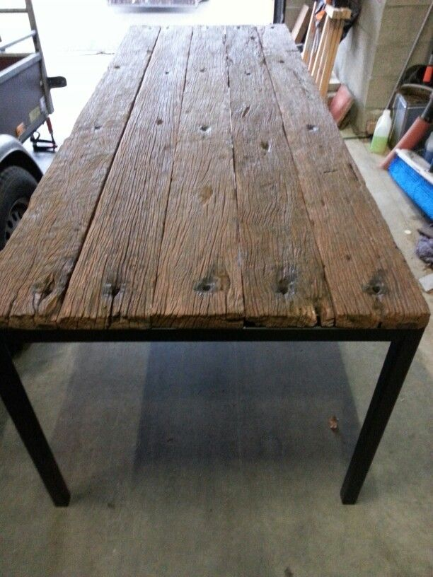 Dining table. Painted metal frame with wood from old train floors. Industrial style.