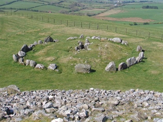 The Loughcrew Cairns in Ireland are a series of tombs dating to 3200 B.C.  Also known as the Hills of the Witch, the thirty-plus cairns and mounds feature some outstanding Neolithic art, and display a solid knowledge of astronomy.  Debate rages as to what the art means or signifies.  The passages of the main cairns are aligned so that the sun will illuminate the back walls on significant days.