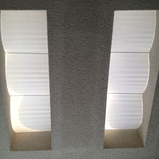Attractive Skylight shades on a budget. Cost: $20 bucks. Materials:  Redi Shade white filtering paper, 4 narrow curtain rods, and velcro tape all purchased from Your local hardware store.