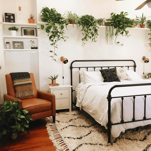 A shelf over the bed is far more interesting than a headboard.