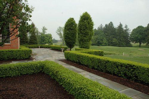 Formal Bluestone Terrace with Boxwood Hedge - Land Architects, Inc.