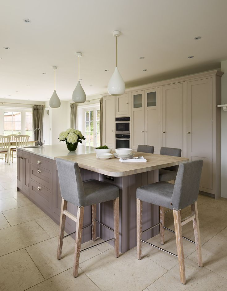A Harvey Jones Shaker kitchen painted in Farrow & Ball 'Elephants Breath', 'Charleston Grey' and 'Pelt'. #kitchens #bespokekitchens #madeintheUK #paintedkitchens #kitchendesign