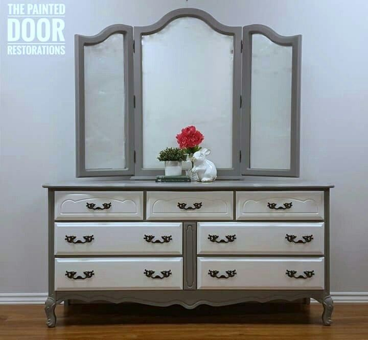 French Provincial Dresser and Triple Fold Mirror.  Body of dresser and mirror painted in Behr's Anonymous Grey with drawers in white and hardware in charcoal. www.thepainteddoorrestorations.com  www.facebook.com/thepainteddoorrestorations  www.instagram.com/thepainteddoorrestorations