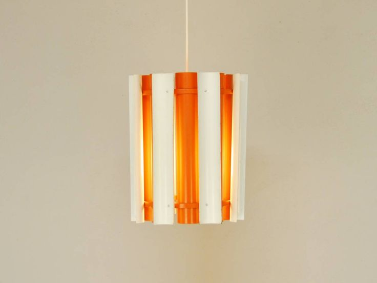 The 'Mexico' pendant is not a very common pendant. It comes in orange with white, like this one and in gold with white. The lamp is a design by Finnish designer Yki Nummi from the 1960's. The lamp is in a very nice condition with little marks that are consistent with age and use. http://novac-vintage.nl/shop/new/mexico-pendant-yki-nummi-orno/