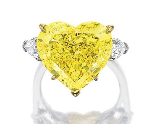 EXCEPTIONAL FANCY VIVID YELLOW DIAMOND AND DIAMOND RING - Sotheby's