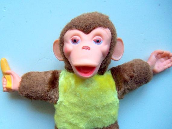 Vintage Mr. Bim Look A-Like Stuffed Toy Monkey With Banana 1950s. $26.00, via Etsy.