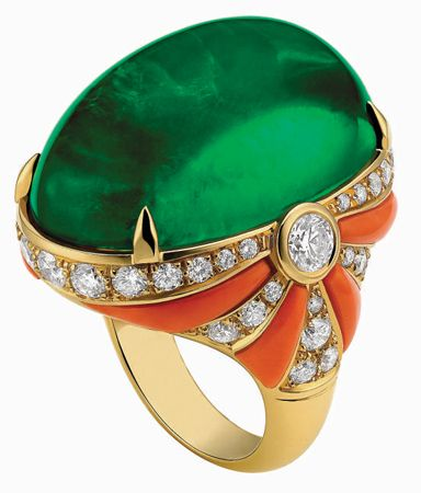 Bulgari Ring with a 48 carat green Tourmaline mounted in a gold ring with diamonds and coral.