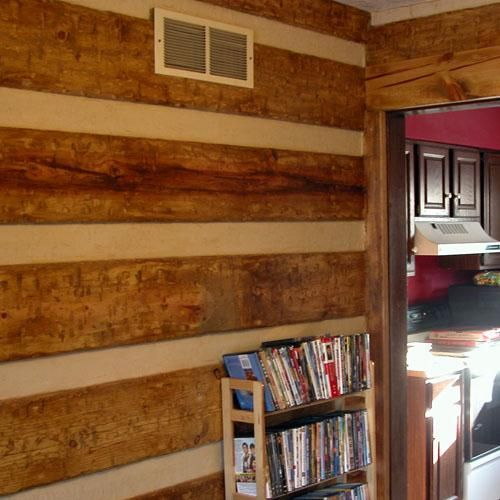 Paint rv cream, attach hooks, hang boards on outside to mimic log cabin. Set up false roof. Keep the nosy neighbors away!