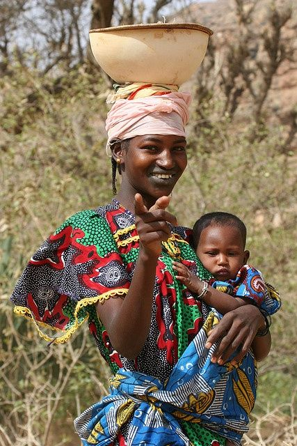 Africa | Portrait of a Peul mother carrying her child, Mali | ©️️ Ferdinand Reus #babywearing