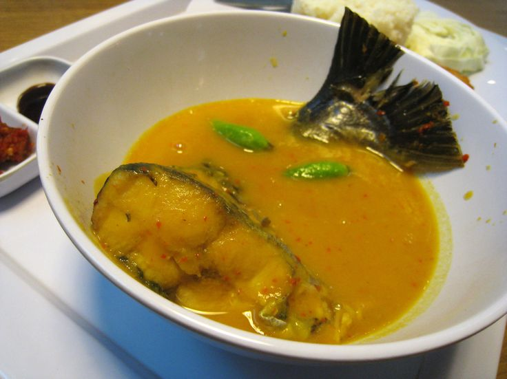 Tempoyak Ikan Patin, pangasius catfish served in sweet and spicy tempoyak sauce, a fermented durian-based sauce. Specialty of Palembang city, South Sumatra. Served at a Palembang food stall at Food Colony Foodcourt, Atrium Senen Plaza, Central Jakarta, Indonesia.