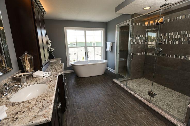 Master Bathroom in JV Model Home #master #bathroom #jerome #village #model #home #tile #wood #design #oversized #custom #poured #glass #surround #shower #tiling #granite #countertops #cabinets #walk #in #closet #free #standing #tub #windows #interior #design #plain #city #ohio #dublin #schools #3 #pillar #homes #luxury #real #estate #builder #new #idea #ideas
