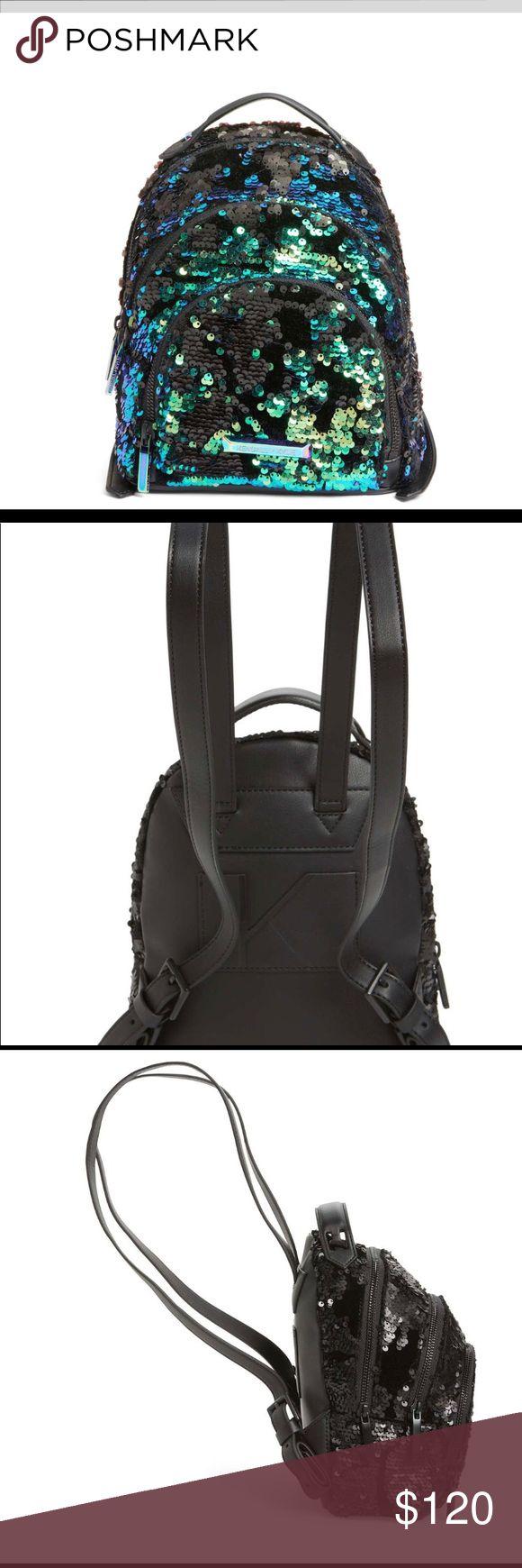Kendall & Kylie Mini Sloane Velvet/Sequin Backpack Kendall & Kylie – Mini Sloane Velvet & Sequin Backpack Color: Metallic (first photo) Kendall & Kylie Bags Backpacks