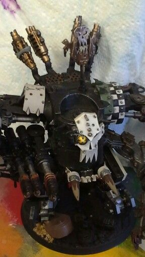 My Deff Dread in progress. This is SUCH a beautiful sculpt I have done very little with the torso or legs. But have bilked up the weapons like wot a Mek would - right? BIG flamer arm with nicely painted scorch if i say so myself!