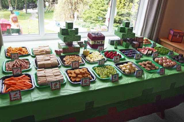 Minecraft party food with papercraft decorations, grass block table cloth, square plates and themed food.