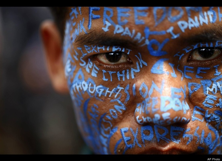 A Nepalese artist appears with his face painted during a protest outside the Katmandu District administration office in Katmandu, Nepal, on Thursday, Sept. 13, 2012. The protesting artists alleged that Nepalese artist Manish Harijan had received death threats from activists of Nepal based World Hindu Federation after displaying combination images of Hindu deities and Western super heroes. (AP Photo/Niranjan Shrestha)
