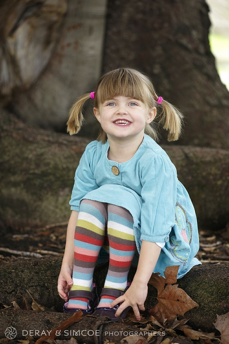 What to wear to a family portrait? Don't be afraid of bright colours in a solo photo, if your child loves to dress in happy colours then let their personality shine through! Photography by DeRay & Simcoe