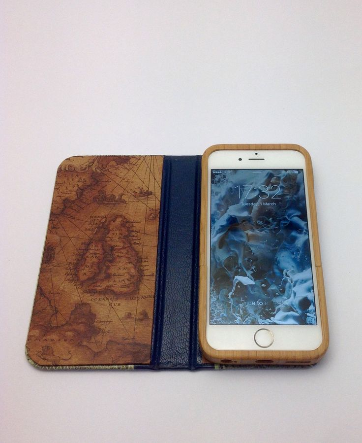Handcrafted iPhone 6s case made of eel skin, snake skin, leather, paper map, and bamboo.