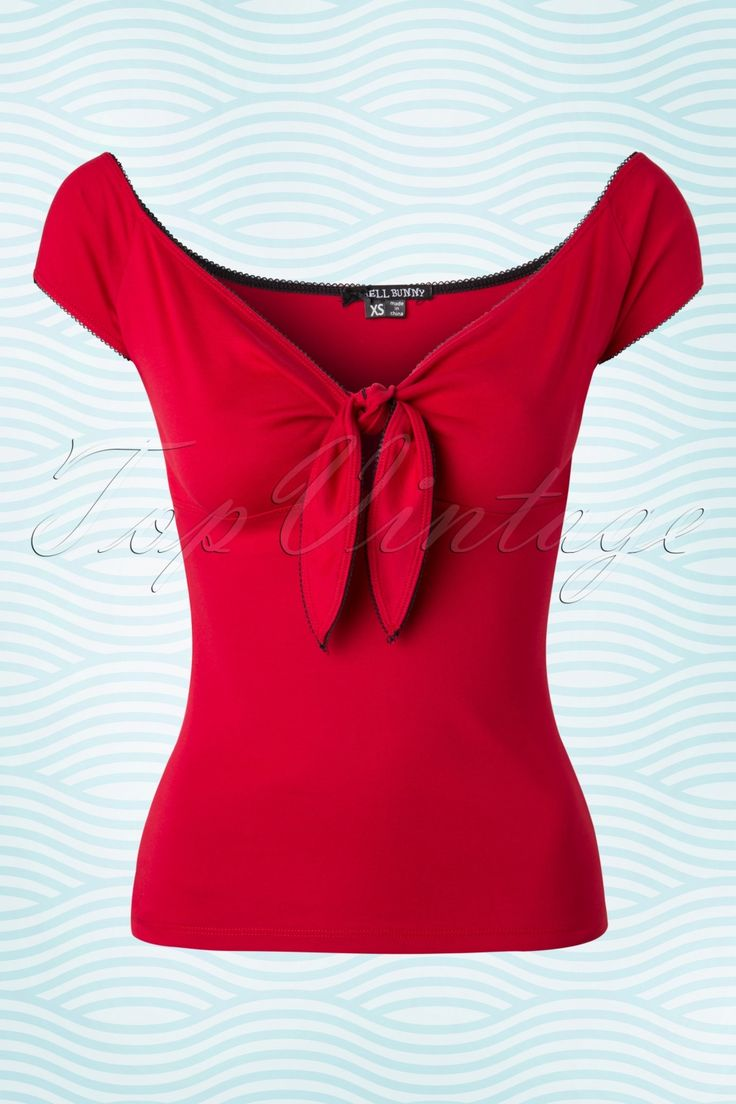 The 50s Bardot Top is THE perfect top for ladies who are looking for a top with a sexy twist!The gorgeous V-neckline is worn slightly off-shoulder and features a knot detailing with a little keyhole for a sexy but sophisticated touch, oh la la! Made from a lovely soft, stretchy dark red cotton for a comfy fit. Hola señorita!    Short sleeves Contrasting black scalloped trims Long enough to pair with regular pants The featured trousers, pumps and skirt are not availa...