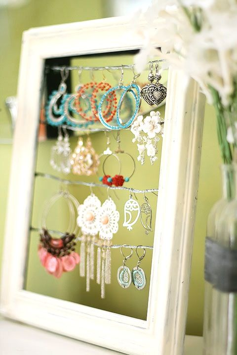 I am so doing this! 1. remove glass from frame 2. add wires 3. hang earrings #earringholder #jewelryorganizer #dresser
