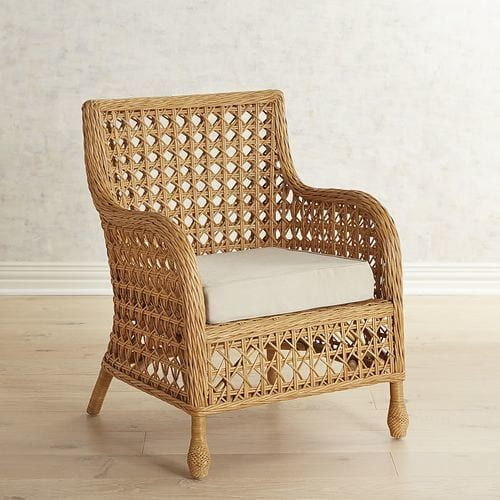 Think of the classic rattan chair and we bet this springs to mind. Hand-woven of honey-hued rattan in a classic diamond pattern, our chair is both sturdy and airy all at once. Maybe that's the magic of this chair—just by looking at it you can feel the ocean breezes. Cushion sold separately.