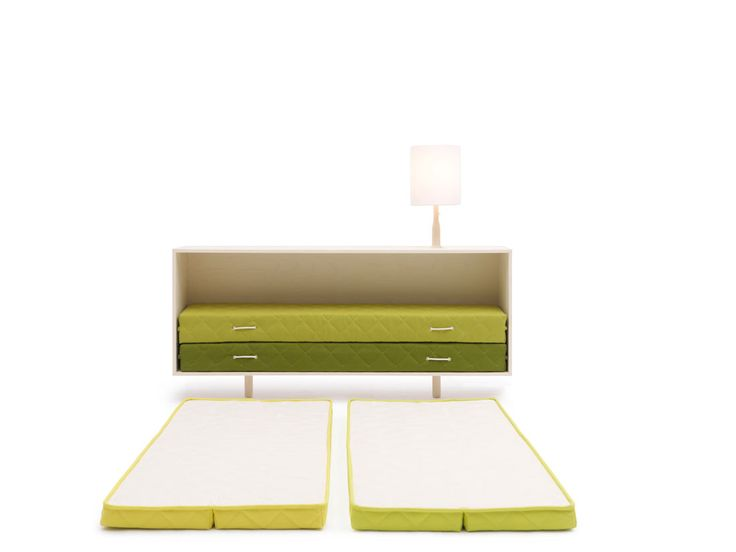 Emergency bed design by Lorenzo Damiani for Campeggi. Mattresses fold up and tuck away into a console.