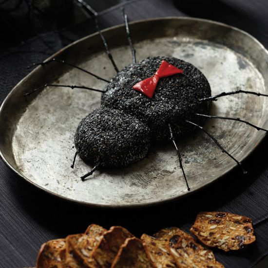 Black Widow Goat Cheese Log | Sautéed shallots and feta cheese flavor this simple spread, which is a delicious hors d'oeuvre at any time of year. Here, it's formed into a spooky spider.