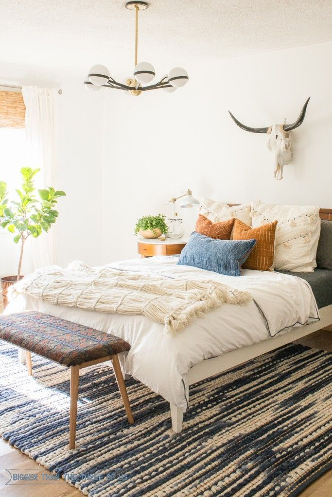 Light and Bright bedroom with mid-century vintage furniture Spare