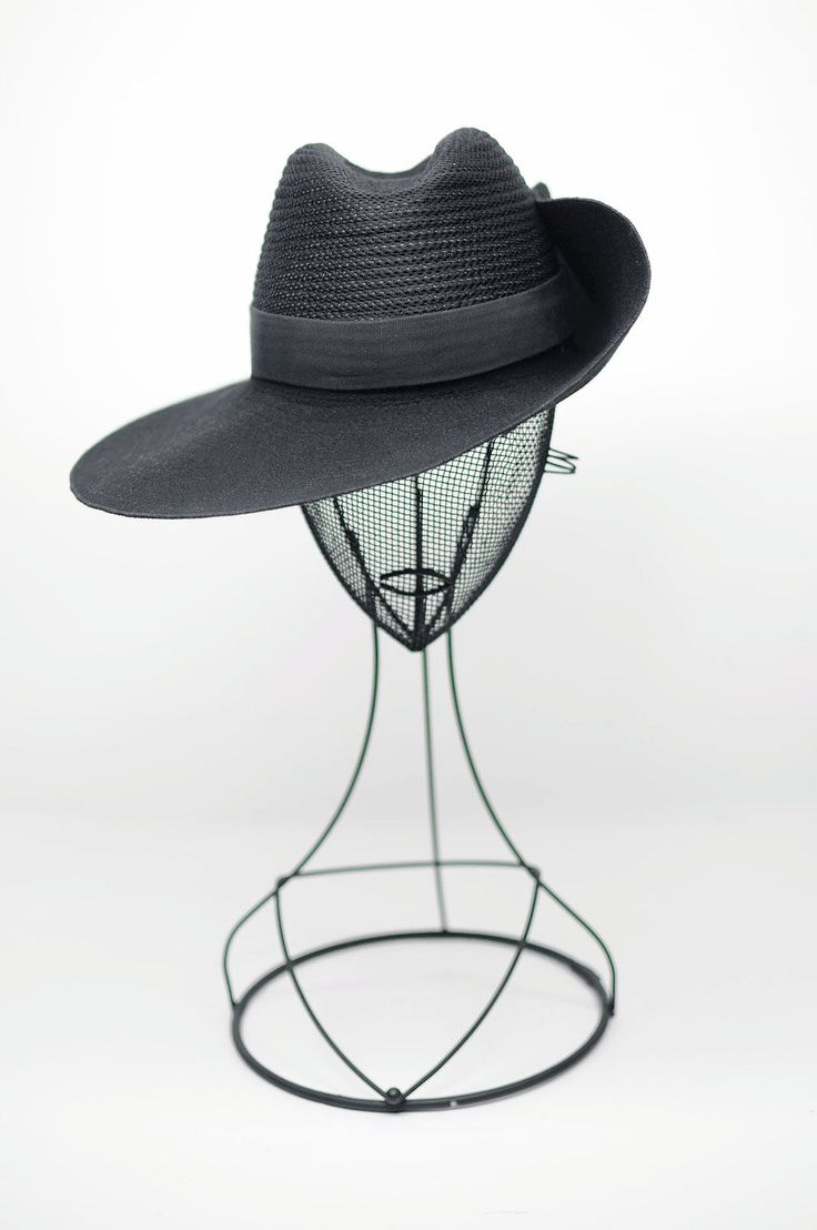 This wide outdoor/jungle/bush hat is unisex .  Made from an original Belgian colonial hat . Handmade on a wood block .  This crown is my original design handcrafted  from La Forme , Paris.   The crown is a top stitch covered 3D Spacer mesh Trimmed with a gros grain in cotton. The brim is side flap with a press dot button and  top stitch circular. Height of the crown is 10 /12/10 cm  Brim is 10 cm to 11,5 cm all round with a fur hem stitch on the edge  This wool felt is made in USA