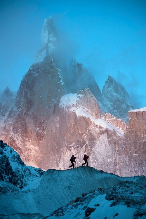 Patagonia - two climbers silhouetted against Cerro Torre peaks #travel #patagonia #climbing