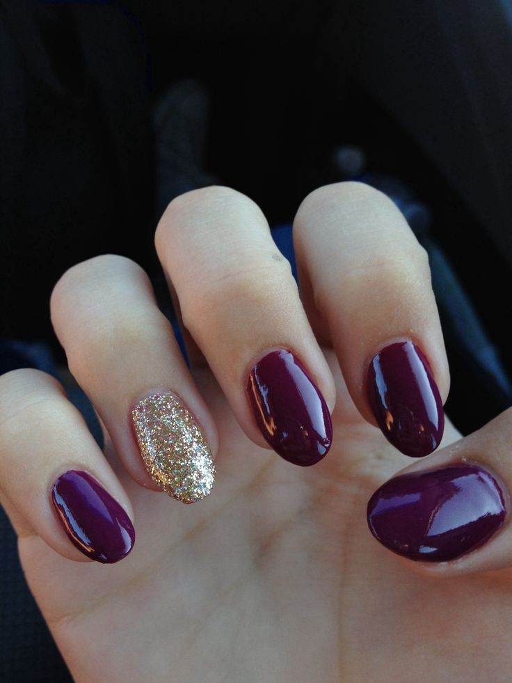 Beautiful maroon and glitter oval nails.