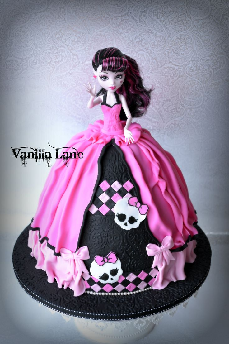 - Miss Draculaura - Take Three.......    This is my third Draculaura I have done now.  I wanted to do something different to my original...lol and then my improved version of the original.  Still wanted her similar....if that makes sense at all.  Anyway I was very happy with how this version turned out.  I also did matching cupcakes which are included in the other pics.  Hope you like her :)