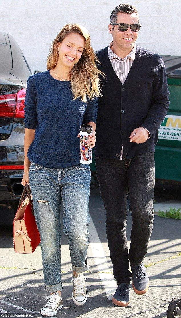 Fresh-faced: Jessica Alba looked radiant and refreshed a day after flying from Dubai to Los Angeles as she strolled with her husband Cash Warren in Los Angeles on Sunday